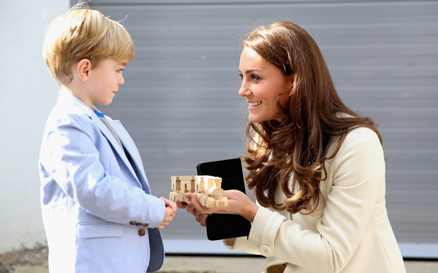 LONDON, ENGLAND - MARCH 12: Catherine, Duchess of Cambridge is presented with a train for Prince George by actor Oliver Barker during an official visit to the set of Downton Abbey at Ealing Studios on March 12, 2015 in London, England. (Photo by Chris Jackson - WPA Pool/Getty Images)