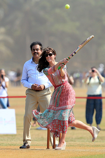 MUMBAI, INDIA - APRIL 10: Catherine, Duchess Of Cambridge enjoys a game of cricket during a visit to meet children from Magic Bus, Childline and Doorstep, three non-governmental organizations, at Mumbai's iconic recreation ground, the Oval Maidan, during the royal visit to India and Bhutan on April 10, 2016 in Mumbai, India. (Photo by Chris Jackson/Getty Images)