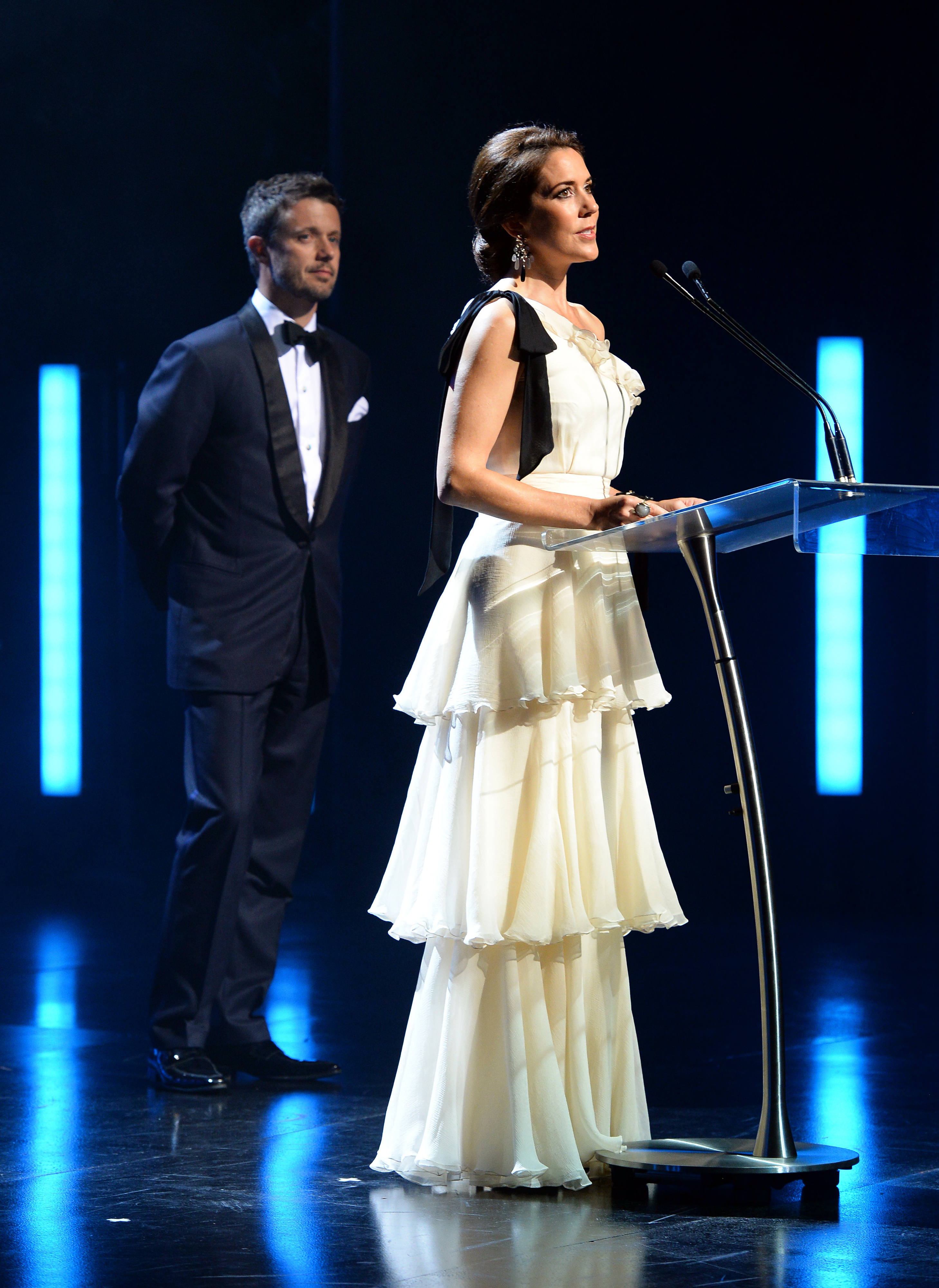 SYDNEY, AUSTRALIA - OCTOBER 28: Princess Mary of Denmark speaks at the Sydney Opera House as Prince Frederik of Denmark looks on as they attend the Crown Prince Couple Awards 2013 at Sydney Opera House on October 28, 2013 in Sydney, Australia. Prince Frederik and Princess Mary are on a five day visit to Sydney and will attend events to celebrate the 40th anniversary of the Sydney Opera House and the Danish architect who designed the landmark, Jorn Utzen. (Photo by William West - Pool/Getty Images)