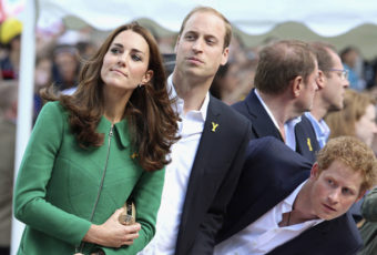 (L-R) Catherine, Duchess of Cambridge, Prince William, Duke of Cambridge, and Prince Harry watch riders at the finish line of the first 190.5 km stage of the Tour de France cycling race from Leeds to Harrogate, July 5, 2014. REUTERS/Chris Jackson/Pool (BRITAIN - Tags: SPORT CYCLING ROYALS ENTERTAINMENT)