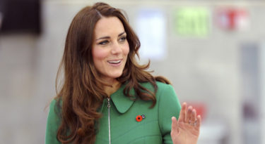 Britain's Kate, Duchess of Cambridge, waves as she attends the opening of the Avantidrome indoor cycle track in Cambridge, New Zealand, Saturday, April 12, 2014. (AP Photo/SNPA, Ross Setford)  NEW ZEALAND OUT