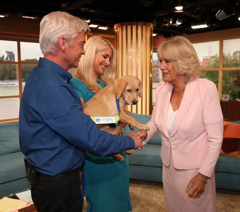 Camilla-met-trainee-guide-dog-named-Clover-during-visit-ITV