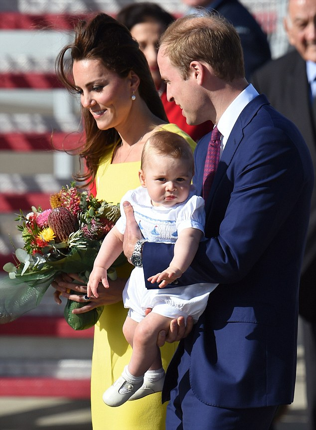 Britain's Prince George (C), is held by his father Prince William (R) as his mother Catherine, the Duchess of Cambridge (L), looks on as they are met upon their arrival from New Zealand at Sydney airport on April 16, 2014. William, his wife Kate and their son Prince George are on a three-week tour of New Zealand and Australia. AFP PHOTO/WILLIAM WESTWILLIAM WEST/AFP/Getty Images