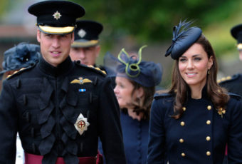 Britain's Prince William, Duke of Cambridge (L), and his wife the Duchess of Cambridge (R) walk through Victoria Barracks in Windsor, west of London, on June 25, 2011, to attend a medal parade for the 1st Battalion Irish Guards Regiment.  AFP PHOTO / CARL COURT/POOL (Photo credit should read CARL COURT/AFP/Getty Images)