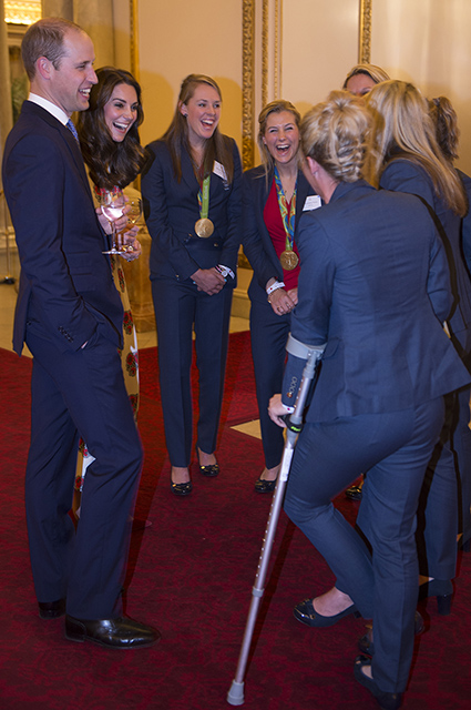 LONDON, ENGLAND - OCTOBER 18: Prince William, Duke of Cambridge and Catherine, Duchess of Cambridge speak with Ladies Hockey Team with Susannah Townsend on crutches at a reception for Team GB's 2016 Olympic and Paralympic teams at Buckingham Palace October 18, 2016 in London, England. (Photo by Eddie Mulholland - WPA Pool /Getty Images)