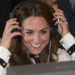 BLETCHLEY, UNITED KINGDOM - JUNE 18:  Catherine, Duchess Of Cambridge listens to a morse code message using a replica radio during a tour the of the restored WWII Codebreaking Huts at Bletchley Park on June 18, 2014 in Bletchley, England. The pre-fabricated wooden huts that housed the secret Government code breaking school during WWII, where encrypted messages sent by the Navy, Army and Air Forces of Germany and its allies were decrypted, translated and analysed for vital intelligence, have undergone a year long restoration. (Photo by Eddie Mulholland - WPA Pool/Getty Images)
