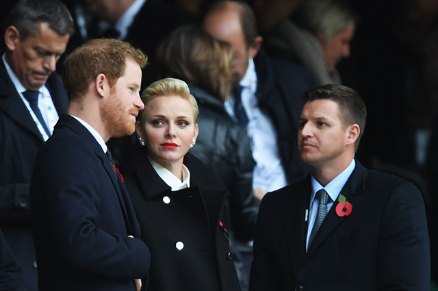 LONDON, ENGLAND - NOVEMBER 12: Prince Harry (L) and Princess Charlene of Monaco (C) are seen in the stand prior to the Old Mutual Wealth Series match between England and South Africa at Twickenham Stadium on November 12, 2016 in London, England. (Photo by Shaun Botterill/Getty Images)